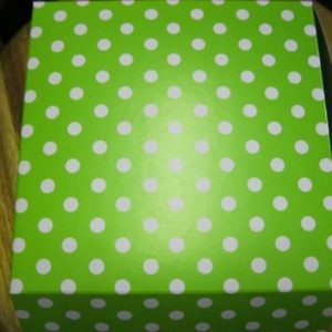 Lime green box with white dots. 5 per pack